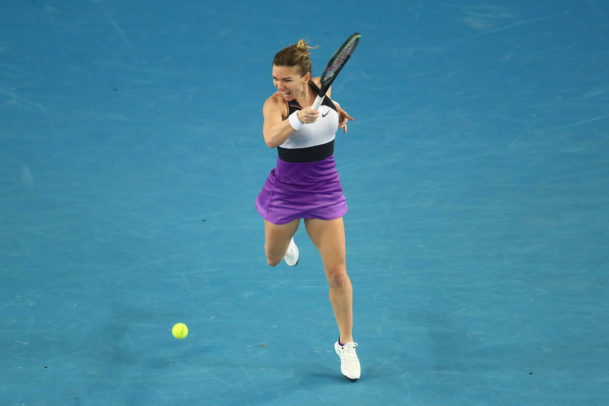 Halep battles back from brink to prevail in deciding set thriller at Australian Open