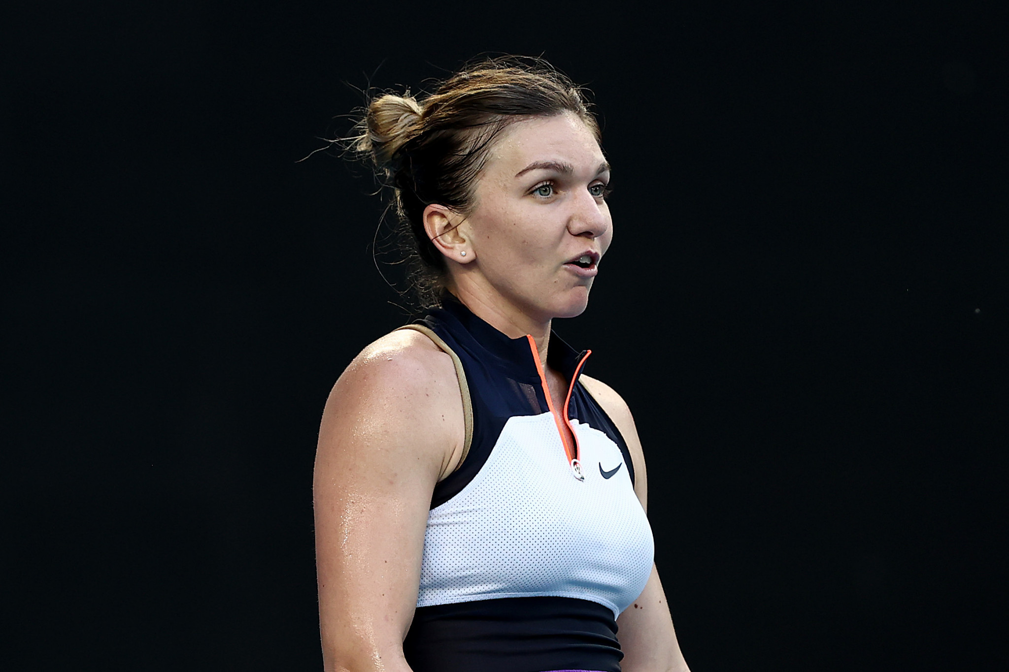 Halep and Djokovic battle to second round wins at Australian Open