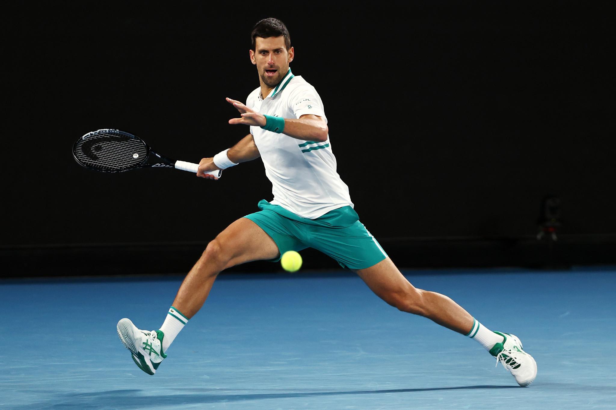 Djokovic battles past Raonic to reach quarter-finals of Australian Open