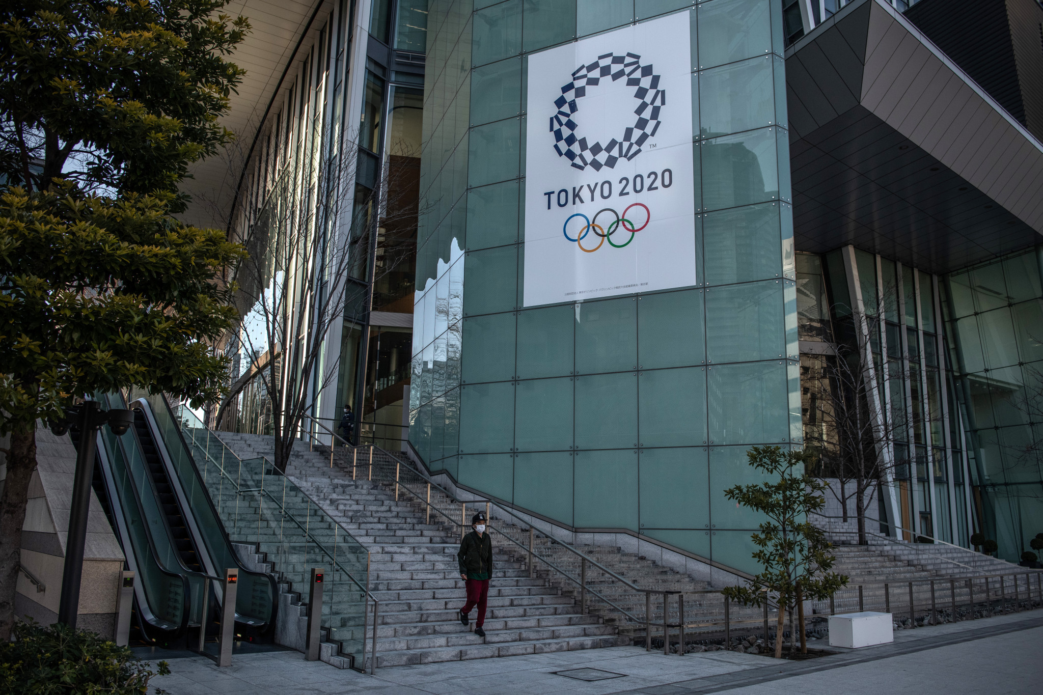 Economy of Olympic host Japan contracted by nearly five per cent in 2020, according to new data