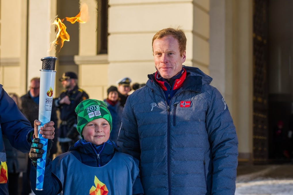 Prince Sverre Magnus of Norway (left) carried the Lillehammer 2016 Torch alongside eight-time Olympic gold medallist Bjørn Dæhlie in Oslo ©Alexander Eriksson