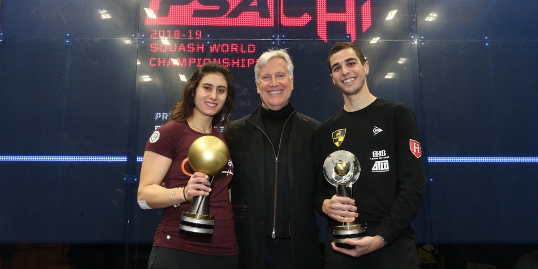 PSA world champions Nour El Sherbini, left. and Ali Farag, right, pictured with title sponsor Mark Walter will return to Chicago in July to defend their titles in an event offering $1million in prize money ©PSA