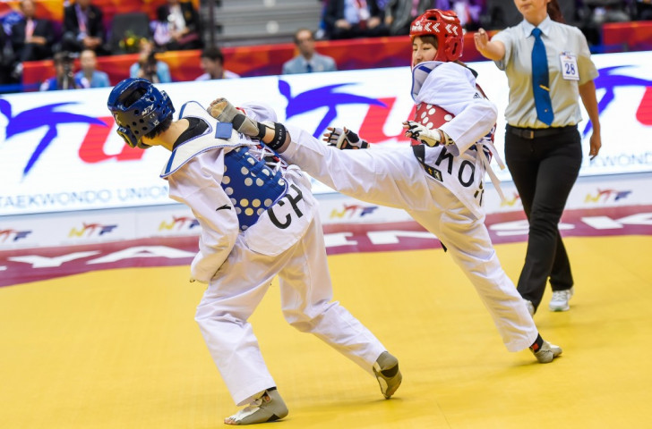 Ha has the last laugh by fighting back to claim shock world taekwondo title