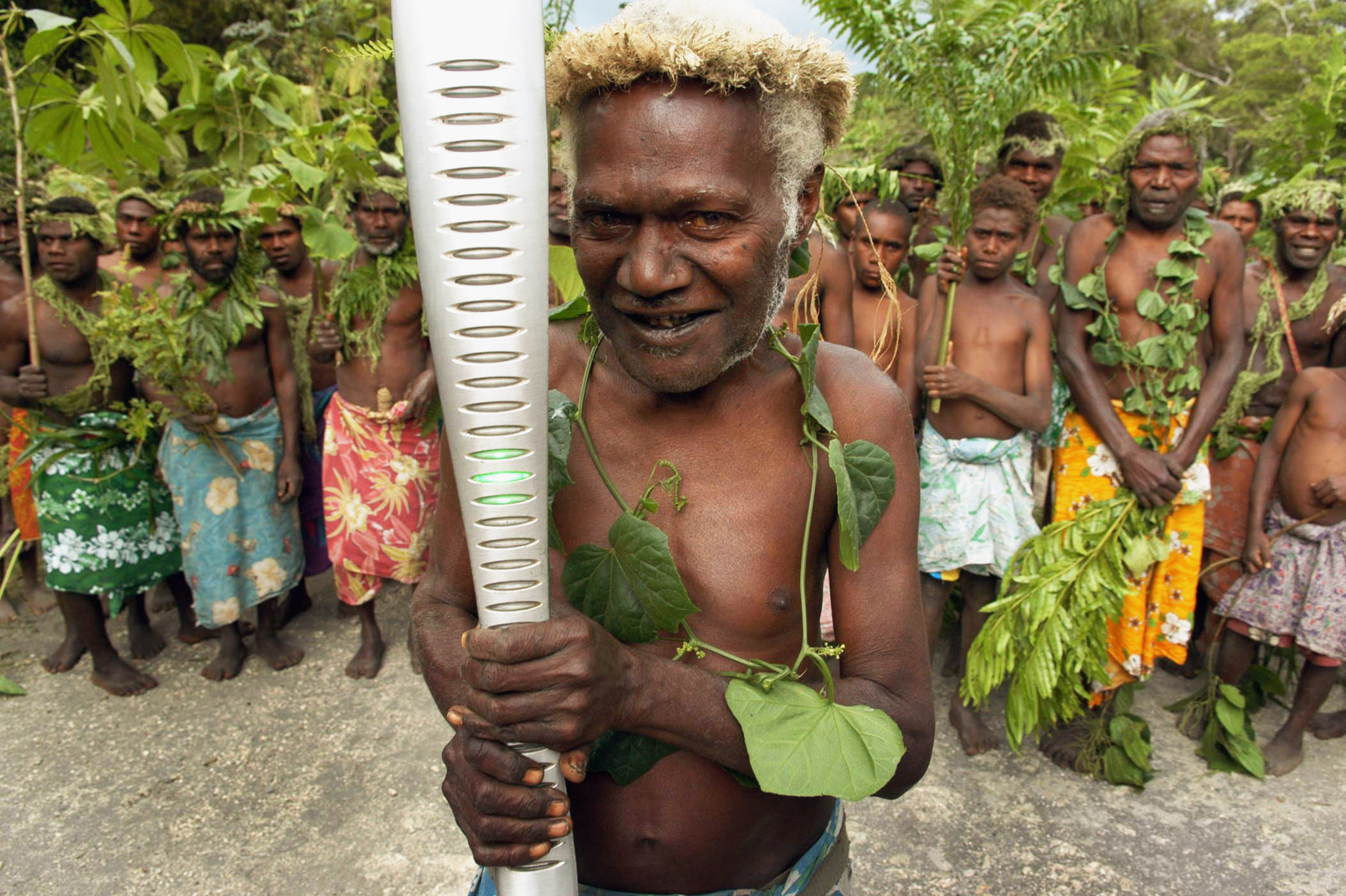 Chief Lobu Joe of Tanna Island welcomes the Melbourne 2006 Queen's Baton to his village in Vanuatu - demonstrating the diversity of the relay ©Getty Images