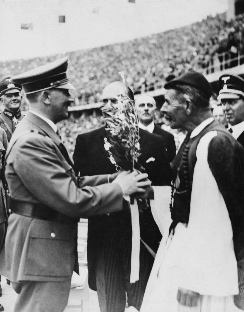 Forty years after his landmark Olympic marathon victory, Spyridon Louis was at the 1936 Berlin Games to present Adolf Hitler with a laurel wreath from the sacred grove of Olympia ©Getty Images