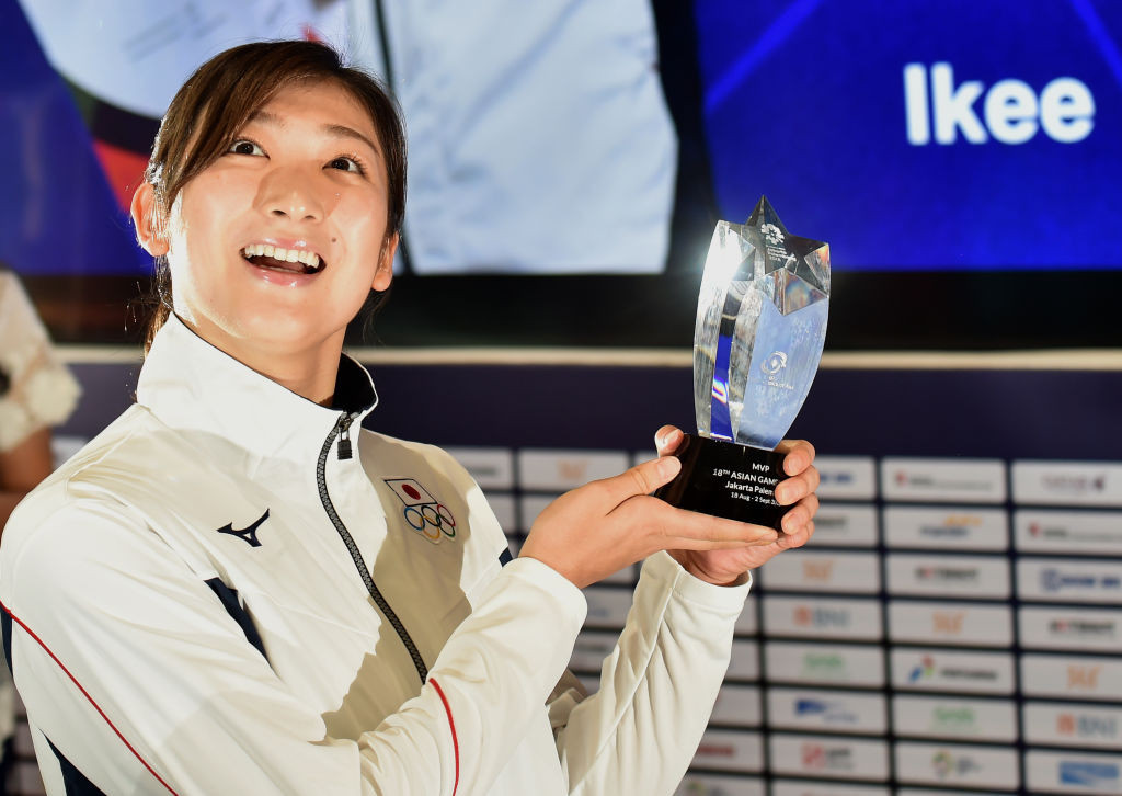 Japan's Rikako Ikee, pictured after being named most valuable player at the 2018 Asian Games where she won six swimming titles, has qualified for this summer's rescheduled Tokyo Olympics having recovered from leukaemia ©Getty Images