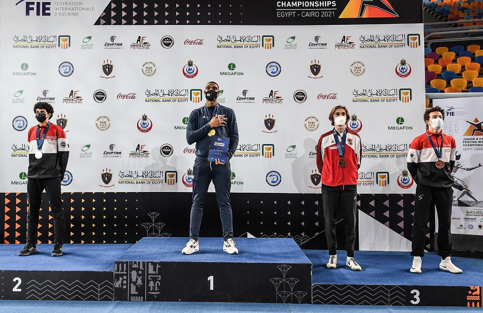 Kendrick Jean Joseph, centre, claimed the gold medal in the men's junior épée today ©Bizzi/FIE