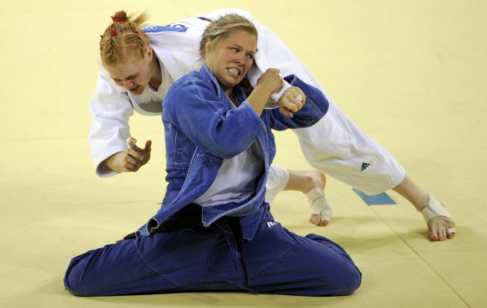 Ronda Rousey, in blue, is an Olympic judo medallist but far more famous for later endeavors  ©Getty Images