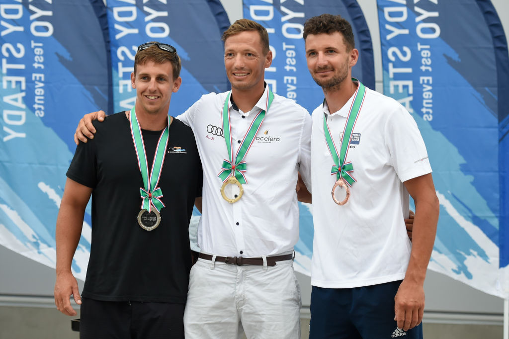 Hungary's Zsombor Berecz, pictured centre after winning the Finn sailing Tokyo 2020 test event at Fujisawa in August 2019, is leader of the Championships after the first two races ©Getty Images