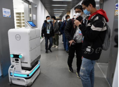 Robots delivering equipment and documents at the National Indoor Stadium as part of the testing of ice venues for the Beijing 2022 Winter Games ©Beijing 2022