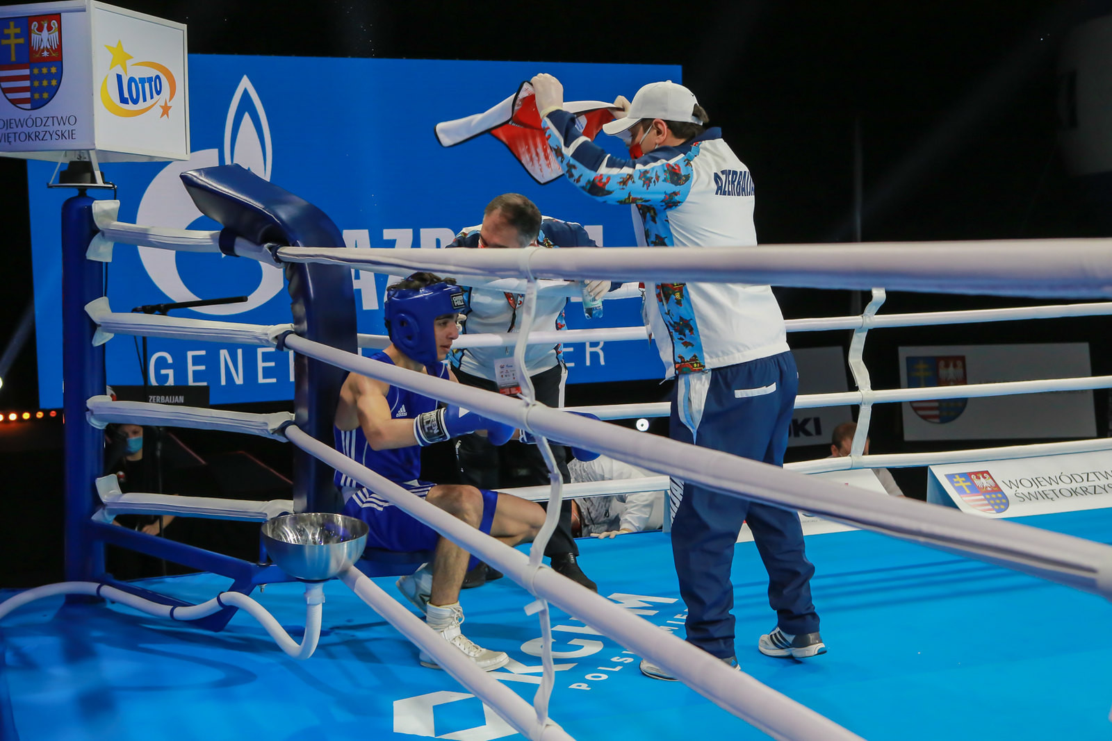 A boxer from Azerbaijan receives instructions from his team during a break between rounds ©AIBA