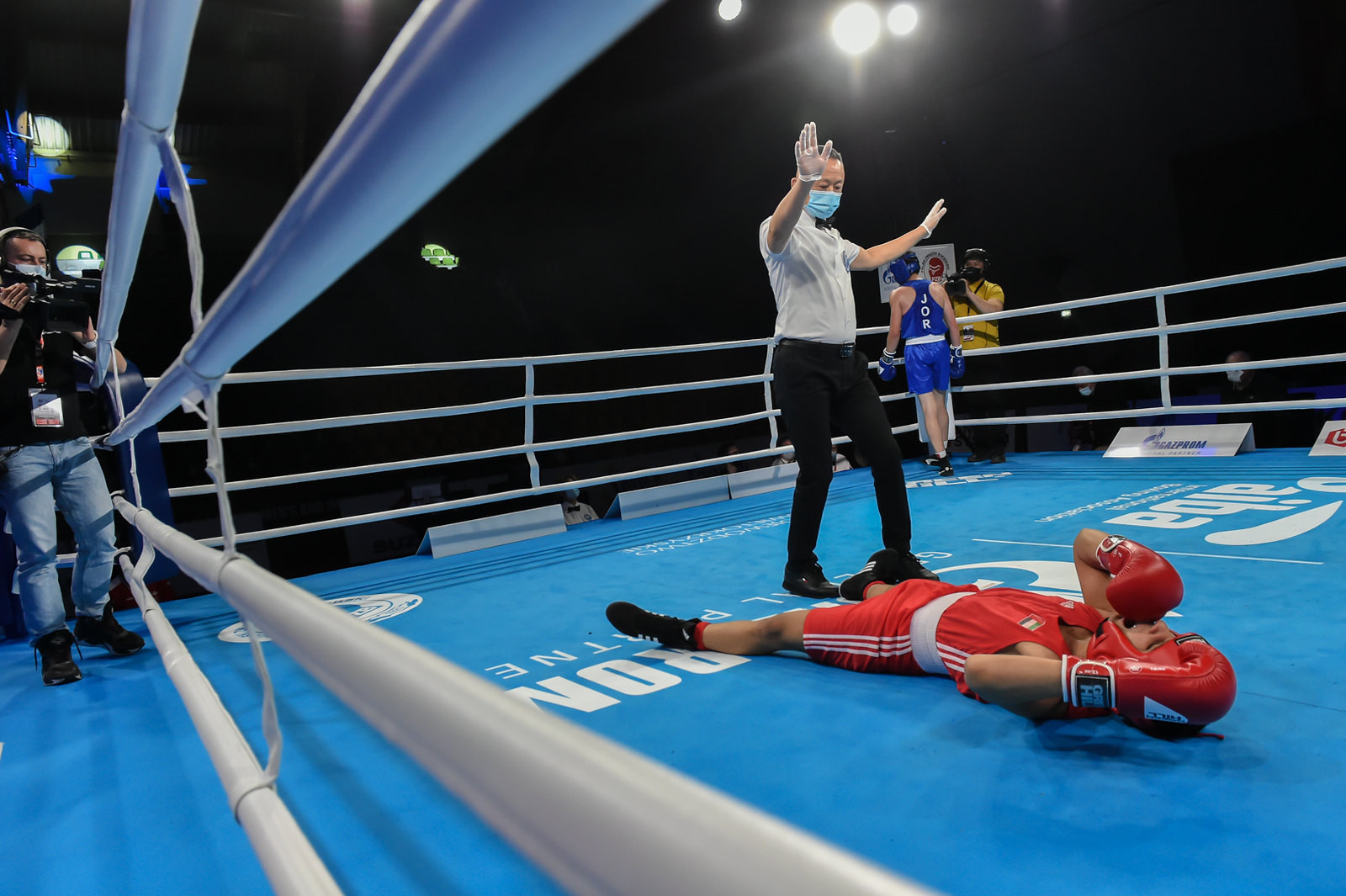 The referee calls a halt to proceedings as a fighter hits the canvas ©AIBA