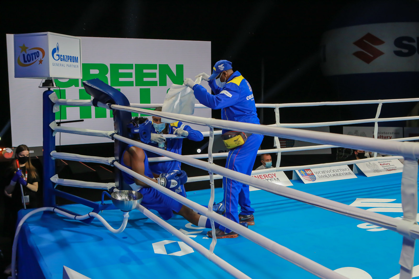 A boxer receives attention from his support team between rounds ©AIBA