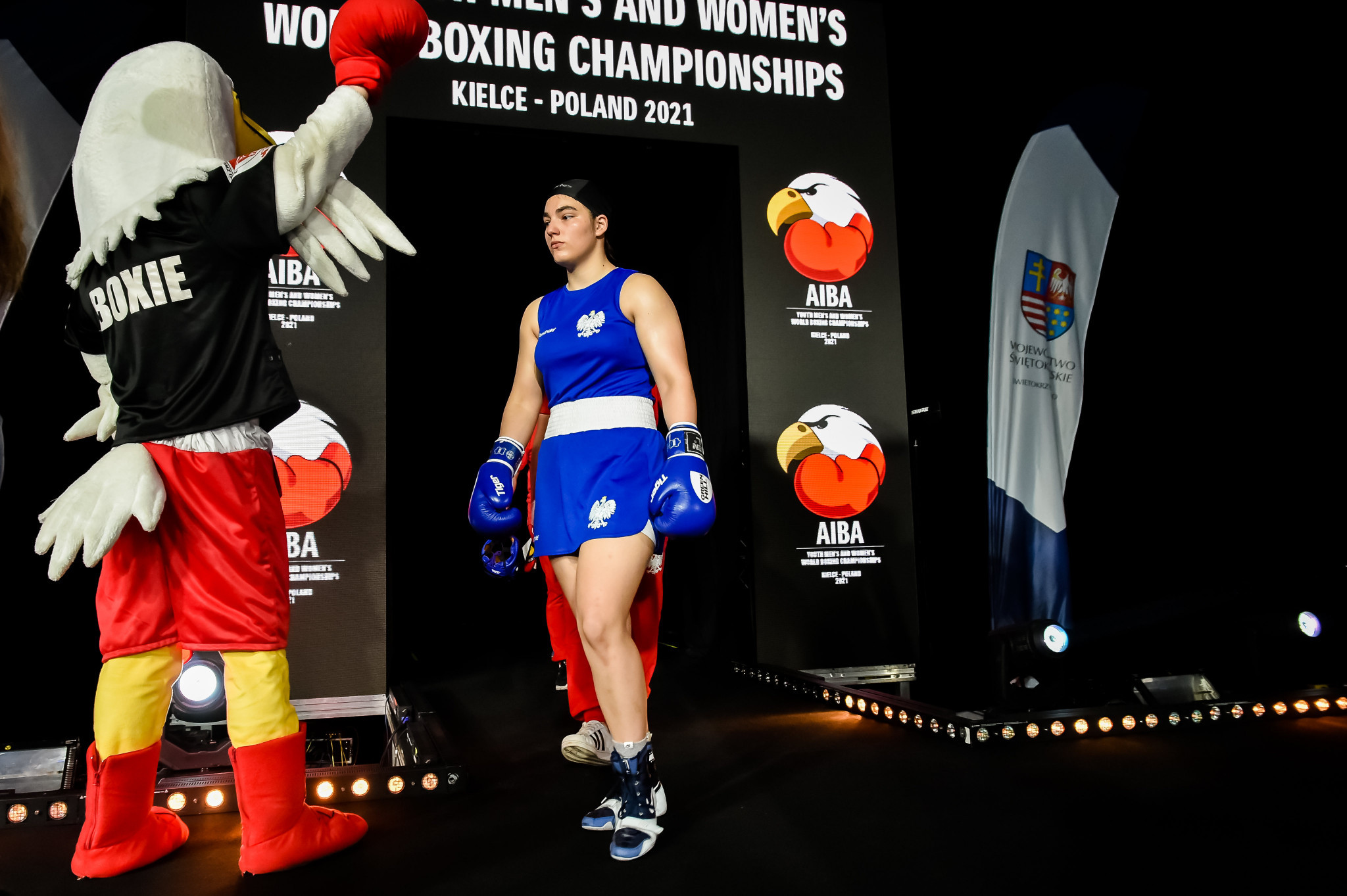 Boxie, the mascot for the Championships looks on as a fighter enters the ring ©AIBA