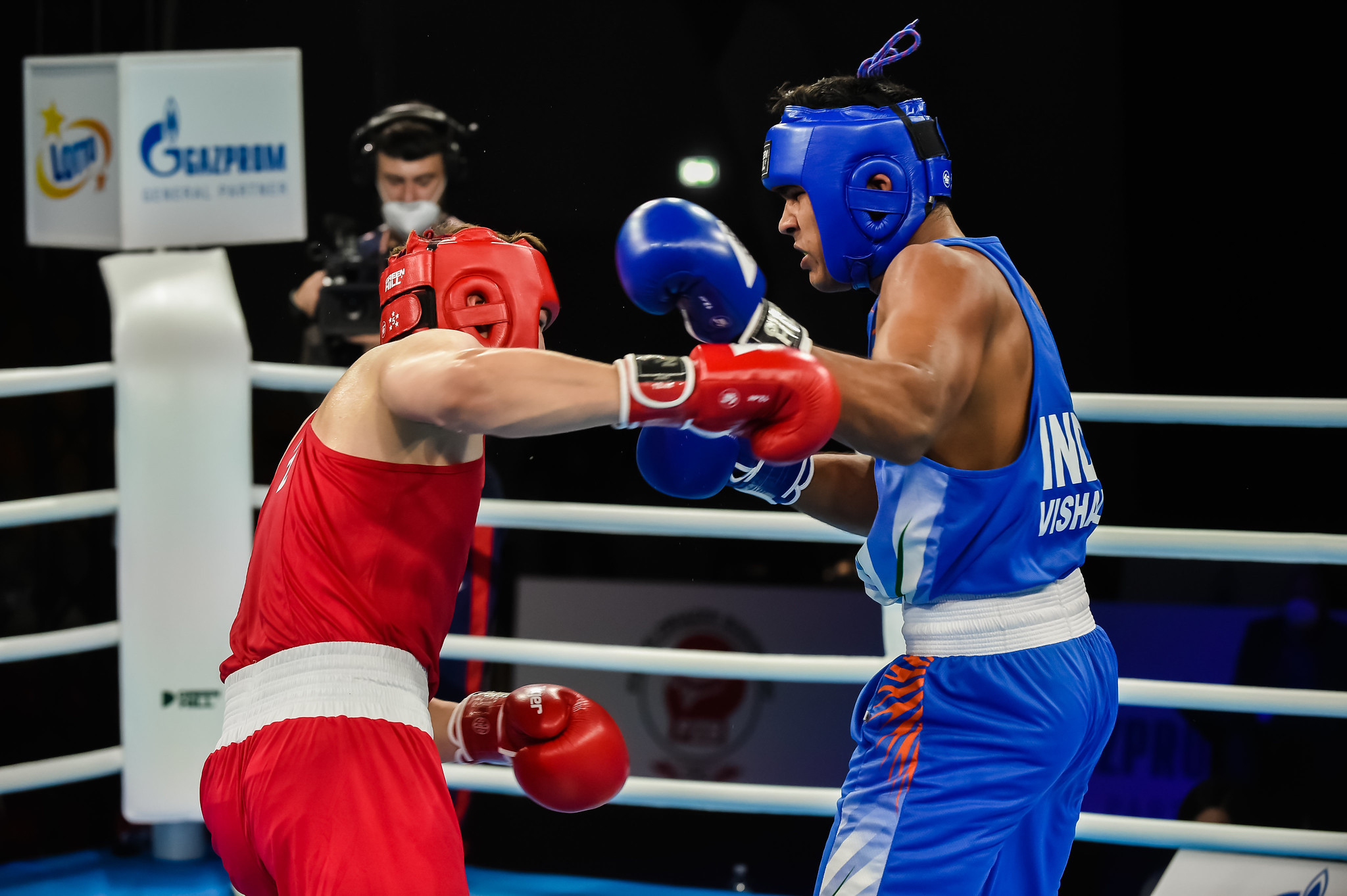 Vishal Gupta, in blue, was one of them in the men's 91kg heavyweight division, beating Kazakhstan's Madi Amirov ©AIBA