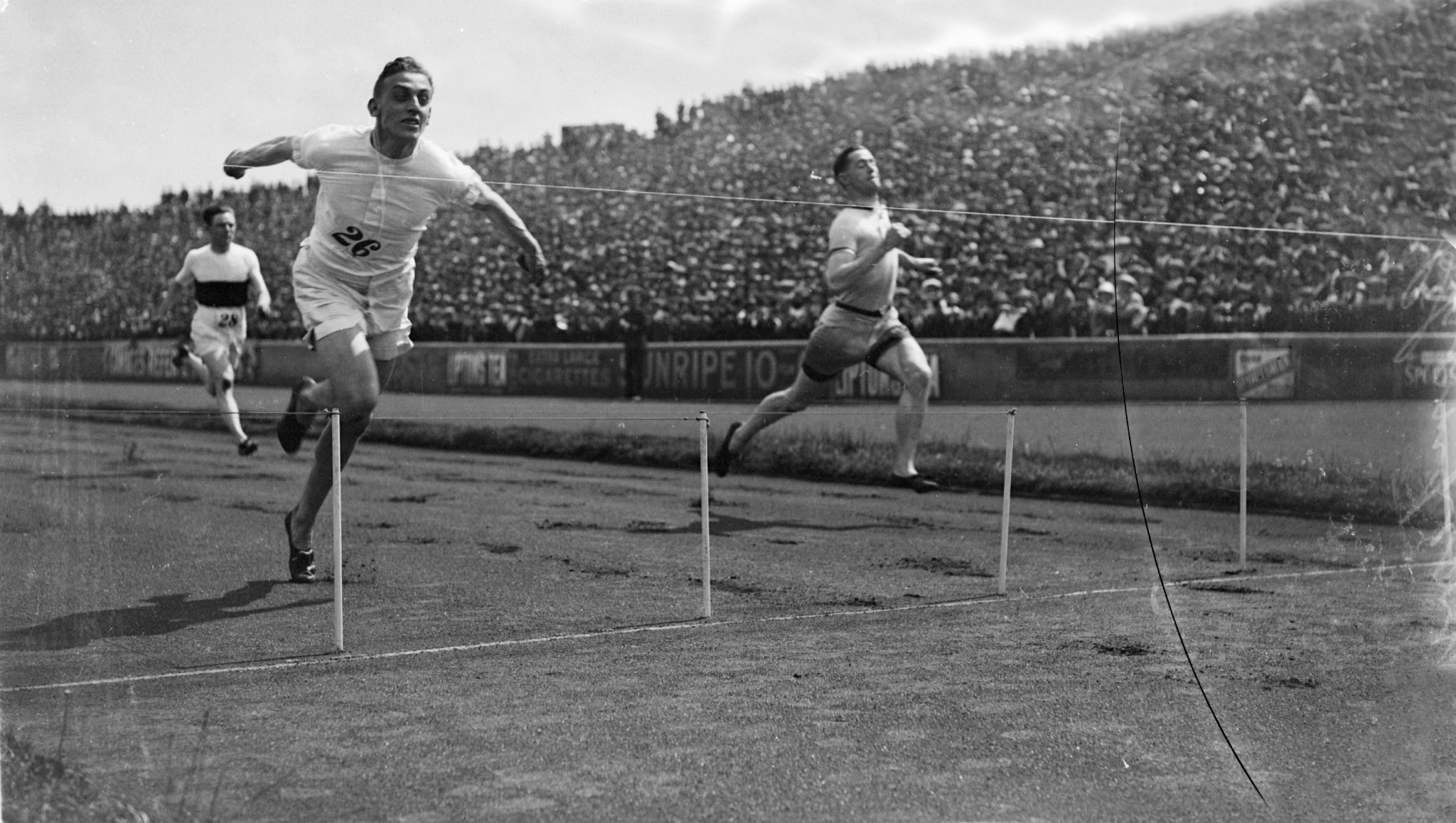 Harold Abrahams dips for the line in a race in 1924 - the same year as the Paris Olympics ©Getty Images