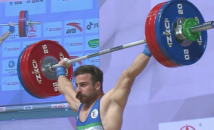 Rostami looks a picture of misery despite winning Asian weightlifting gold