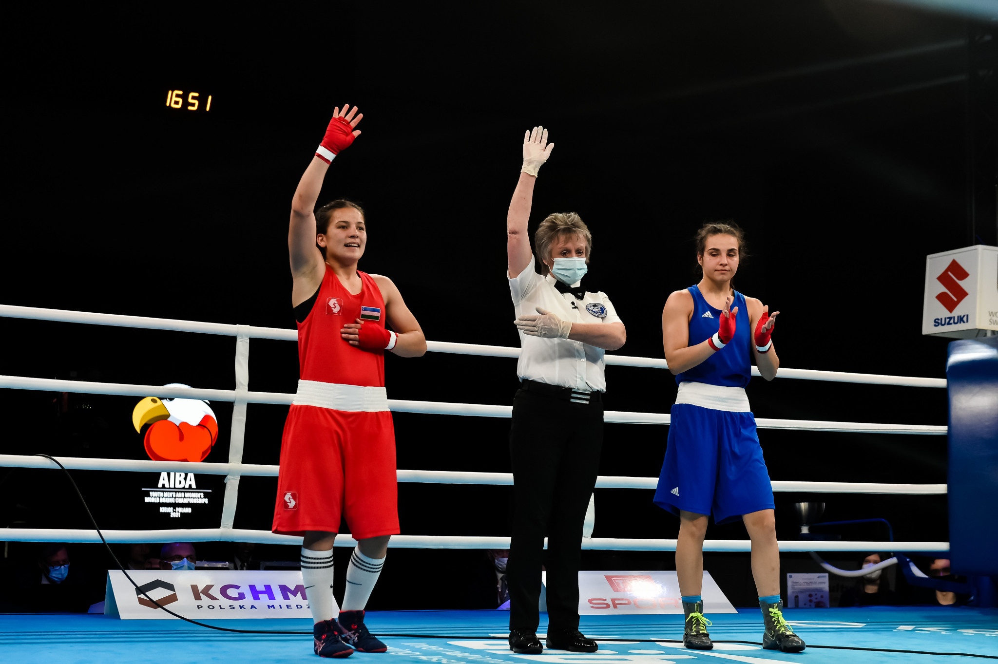 The referee declares the winner of one of the day's ten women's finals in Kielce ©AIBA