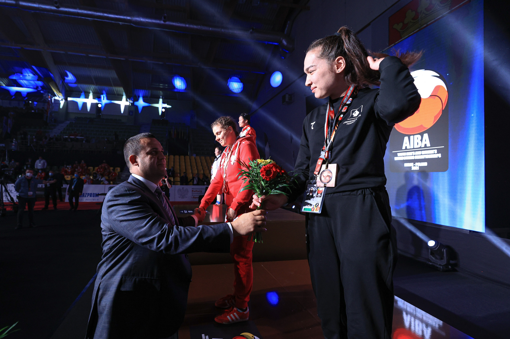 AIBA President Umar Kremlev hands out flowers during a medal ceremony ©AIBA
