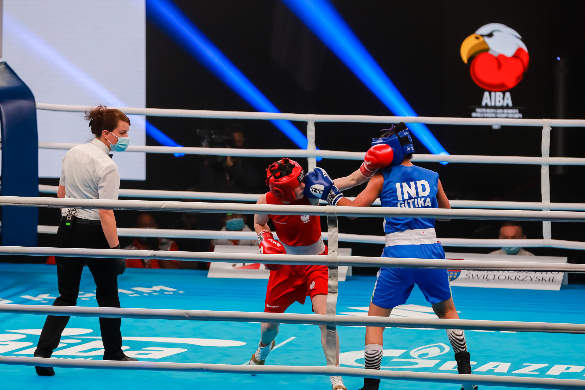 Gitika, in blue, was the first of India's winners of the day in the light flyweight category ©AIBA