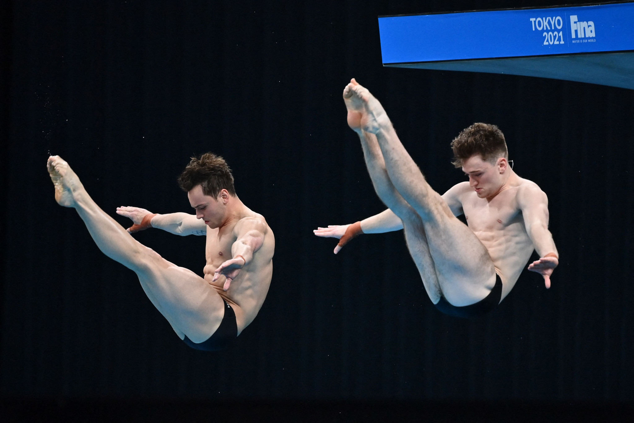 Britain's Tom Daley, left, praised the Organising Committee for being