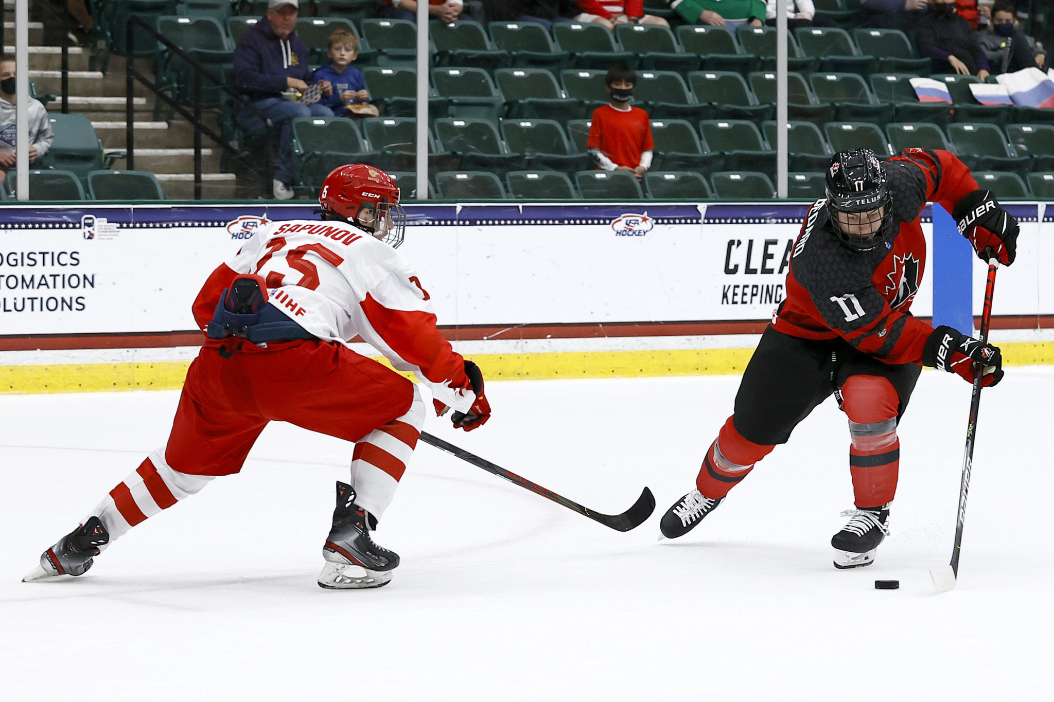 Connor Bedard, right. scored Canada's first goal and was named in the team of the tournament  ©Getty Images