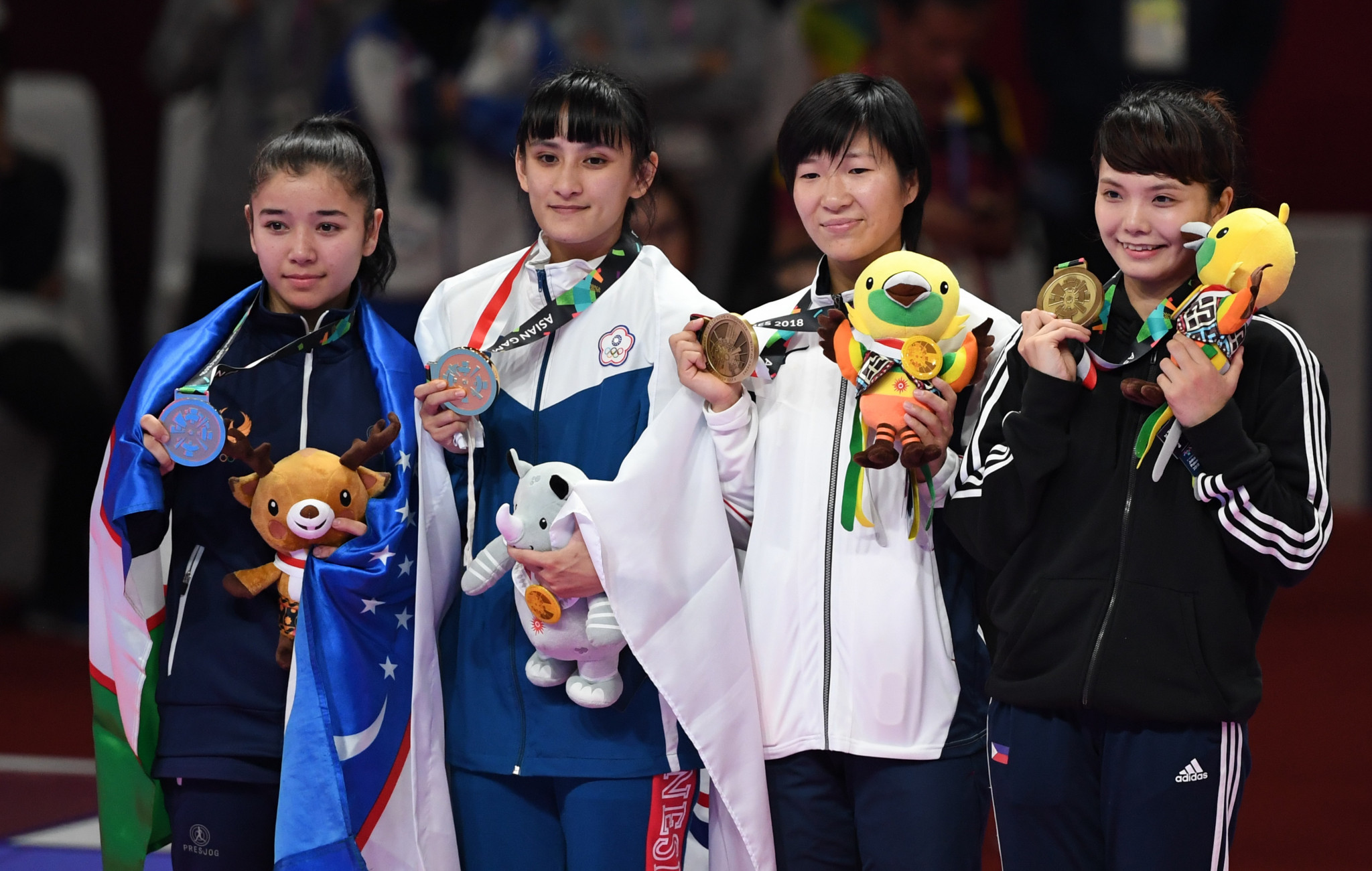 Junna Tsukii, far right, won a bronze medal at the 2018 Asian Games - the Philippines' only medal in the sport ©Getty Images