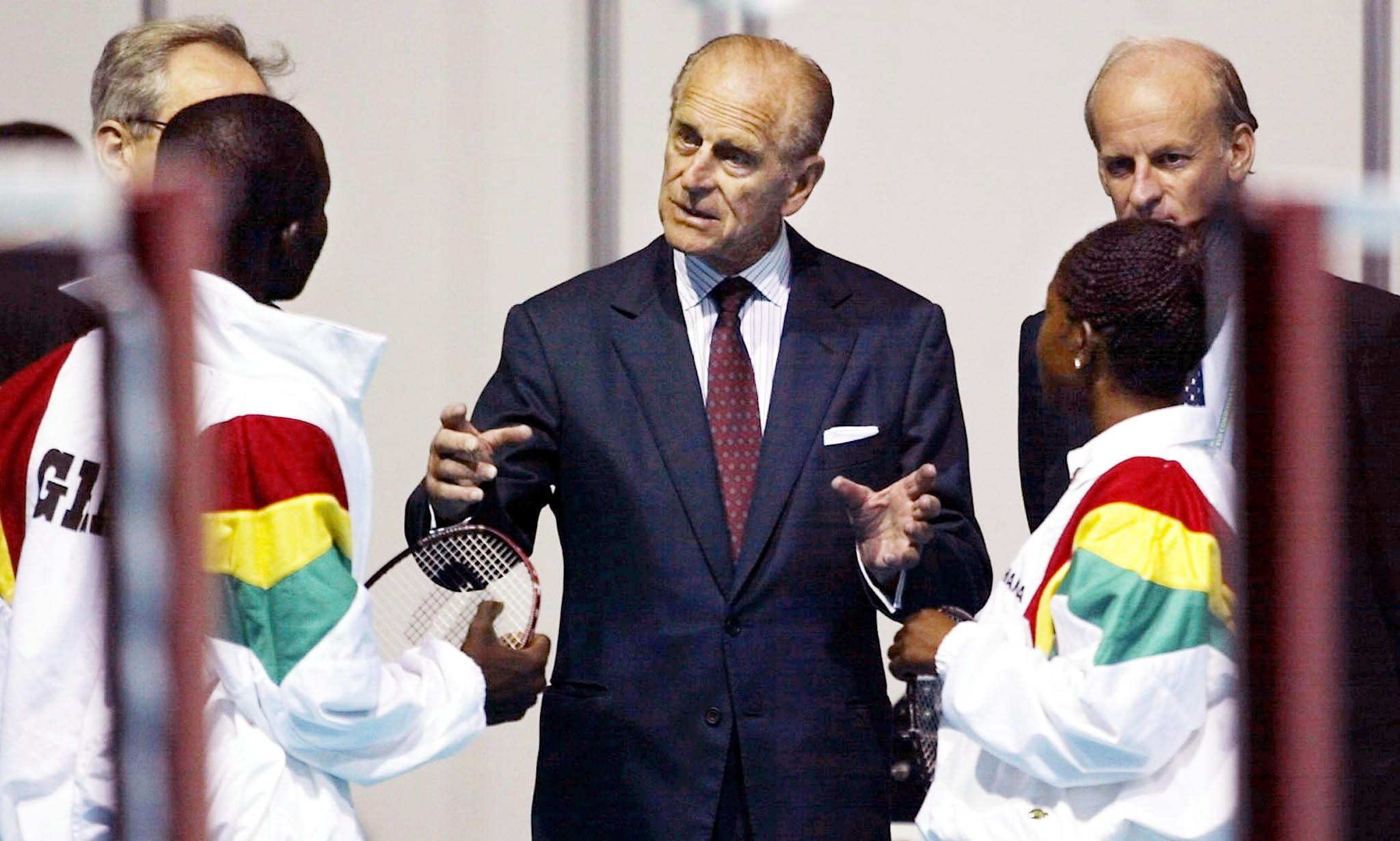 Prince Philip chats to a mixed doubles badminton team from Ghana during the Manchester 2002 Commonwealth Games ©Getty Images
