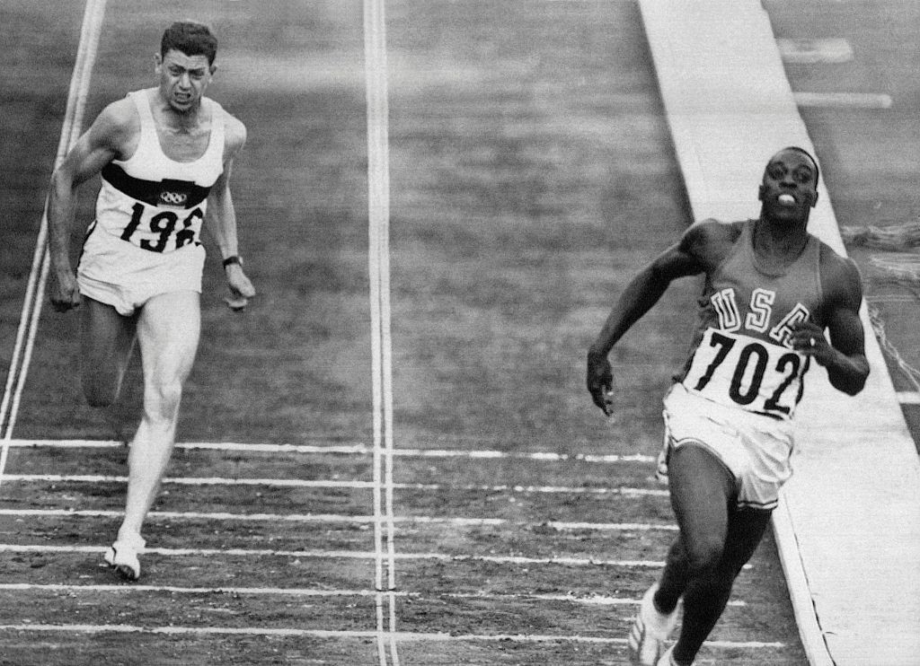 Bob Hayes, pictured winning the 1964 Olympic 100 metres title in Tokyo, went on to become a Super Bowl winner with Dallas Cowboys in 1972 ©Getty Images