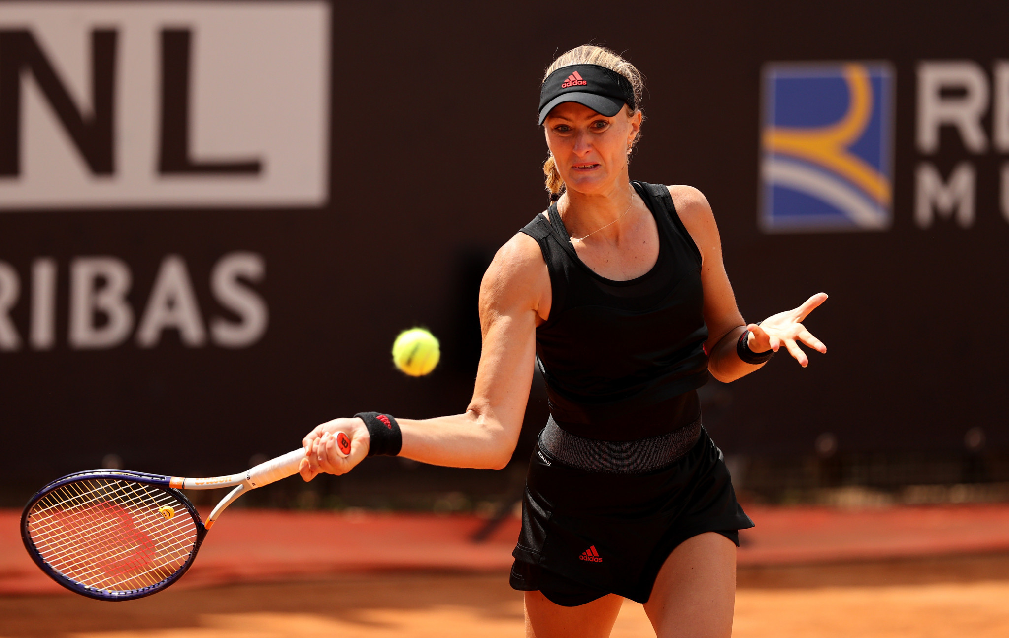 Kristina Mladenovic gained revenge against Belinda Bencic with an impressive performance in Rome ©Getty Images