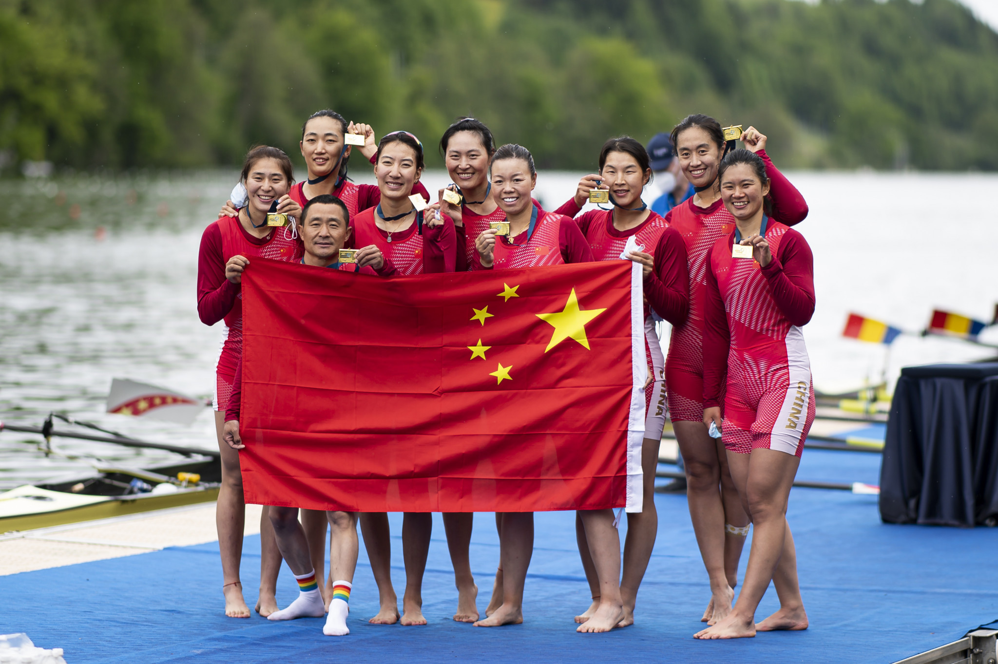 The Chinese women's eight crew celebrate after securing their place at Tokyo 2020 ©Getty Images