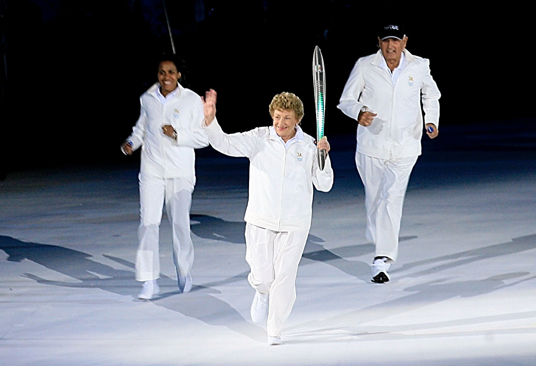 Marjorie Jackson-Nelson, holding the Queen's Baton at Melbourne 2006, has received life membership from Commonwealth Games Australia ©Getty Images