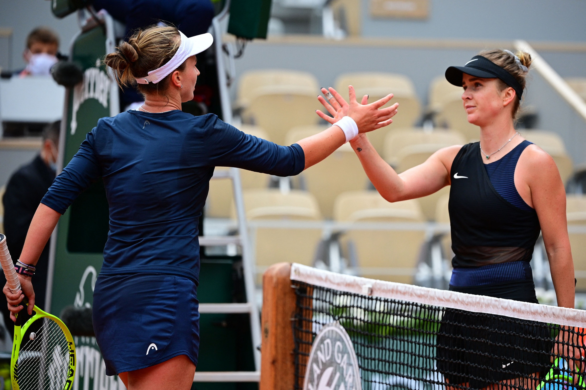Elina Svitolina congratulates Barbora Krejčíková at the net after losing in the third round ©Getty Images