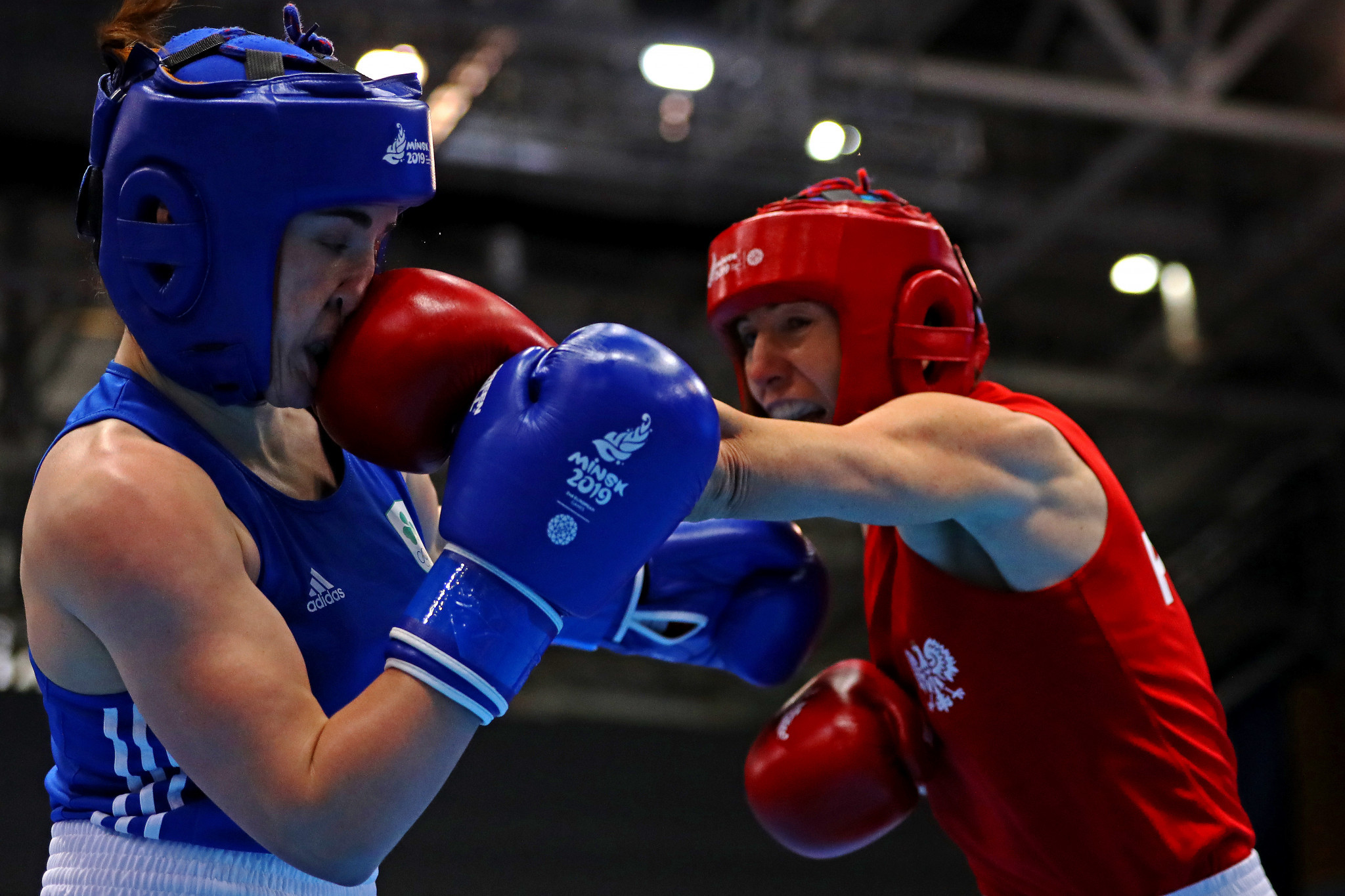 Karolina Koszewska of Poland, in red, is one win away from Tokyo 2020 after winning her semi-final in the women's welterweight category box-offs ©Getty Images