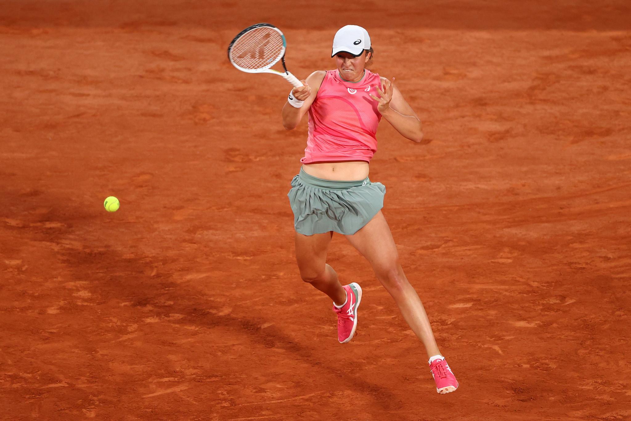 Djokovic battles back to win in five sets as defending women's champion Swiatek advances at French Open