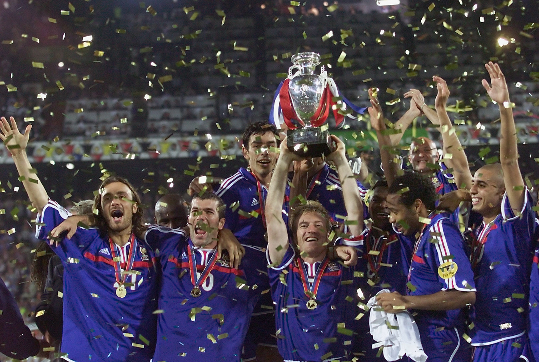 Didier Deschamps, holding the trophy, won the European Championship as a player 21 years ago ©Getty Images