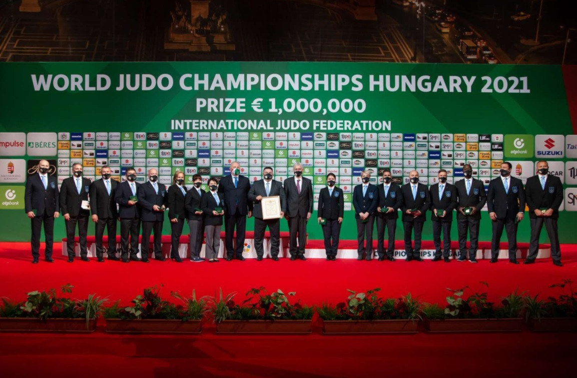The International Judo Federation presented medals to 16 referees officiating at the World Championships in Budapest ©IJF