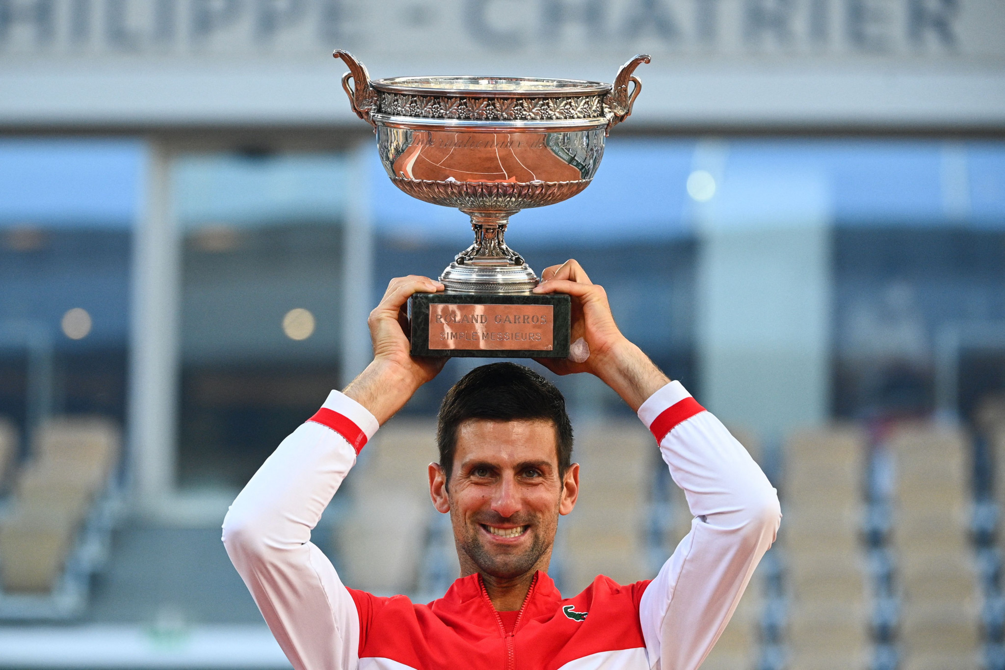 Djokovic comes from two sets down to win second French Open title