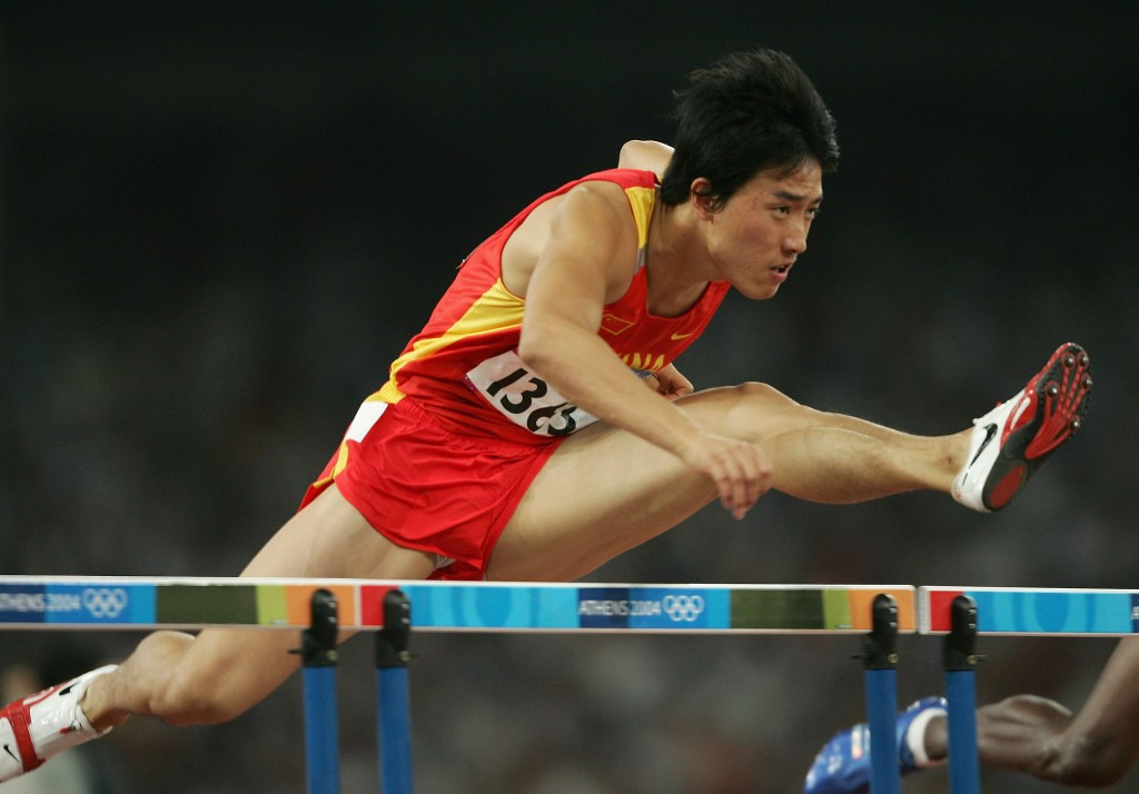 Liu Xiang, pictured en route to the 2004 Olympic 110m hurdles title, will officially mark his retirement tomorrow night at the IAAF Diamond League meeting in his native Shanghai ©Getty Images