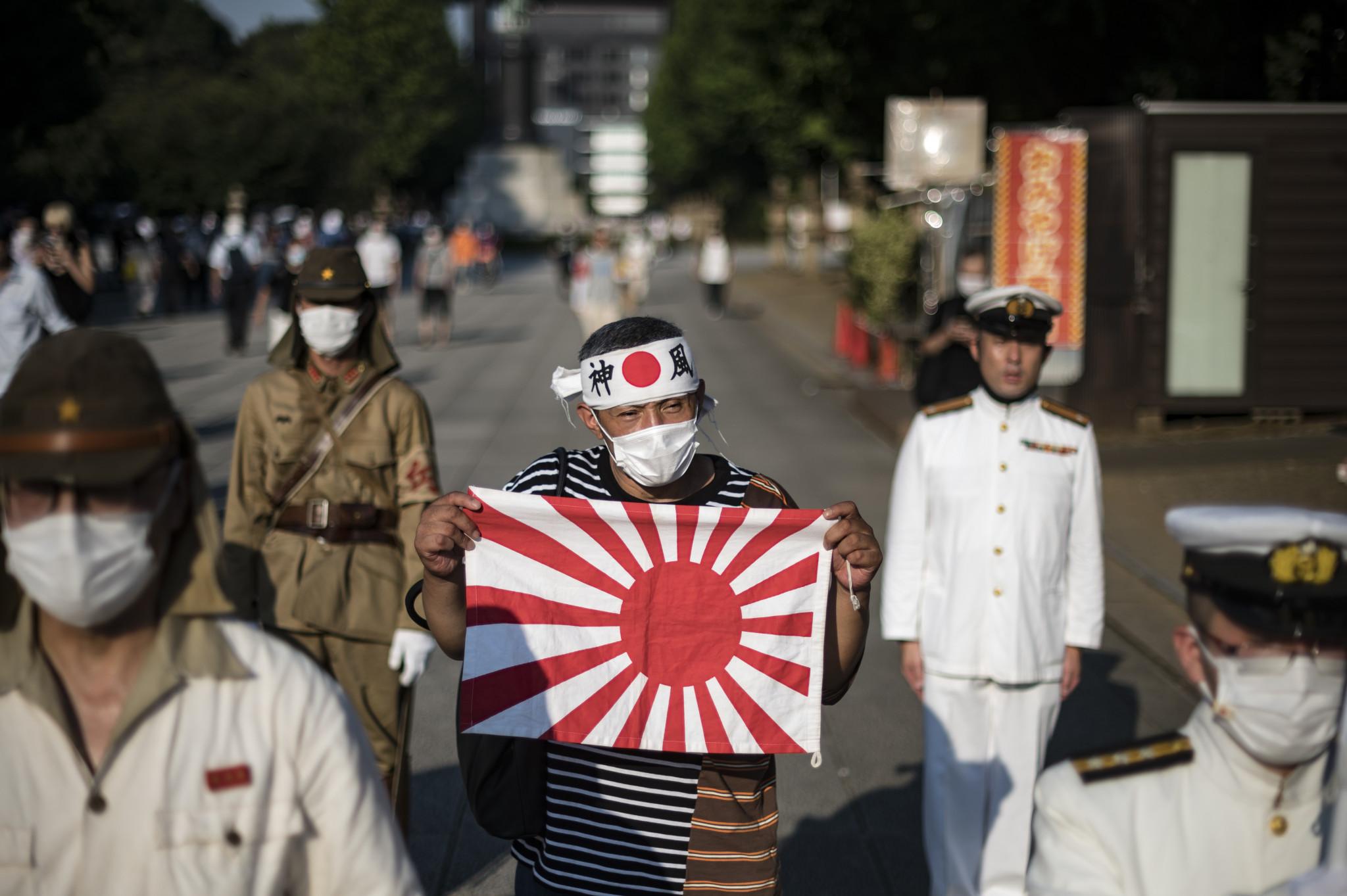 KSCO는 일본 소수당 의원들이 한국 현수막에 항의한 후 IOC가 욱일기 사용을 반대한다고 밝혔습니다. © Getty Images