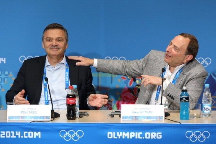 IIHF Pesident René Fasel pictured alongside NHL Commissioner Gary Bettman during a tense press conference at the 2014 Olympics in Sochi where a deal for the top players to take part was reached late ©Getty Images