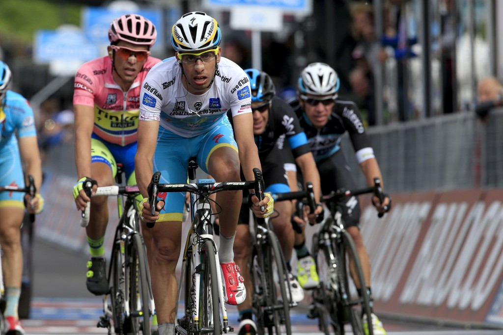 Fabio Aru (white) trails race favourite Alberto Contador (pink) by four seconds in the overall classification