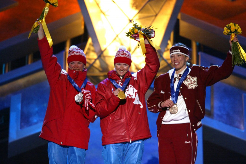 Beckie Scott (right) originally won the bronze medal at Salt Lake City 2002 behind Olga Danilova and Larissa Lazutina before the two Russians  were banned for doping and stripped of their medals ©Getty Images