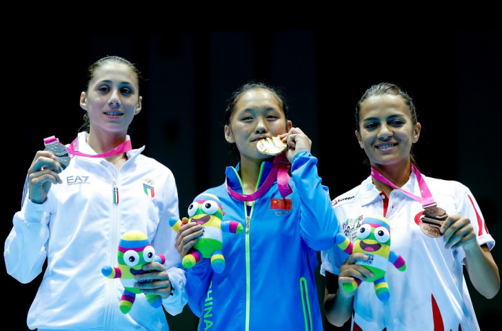 Italy's Irma Testa (left), a Nanjing 2014 Youth Olympic Games silver medallist  used her height advantage successfully against Chinese Taipei's Liu Chia Chun