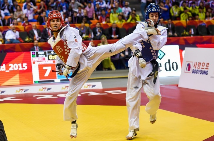 Servet Tazegul (left) kicked and spun his way to a second world title in Chelyabinsk ©WTF