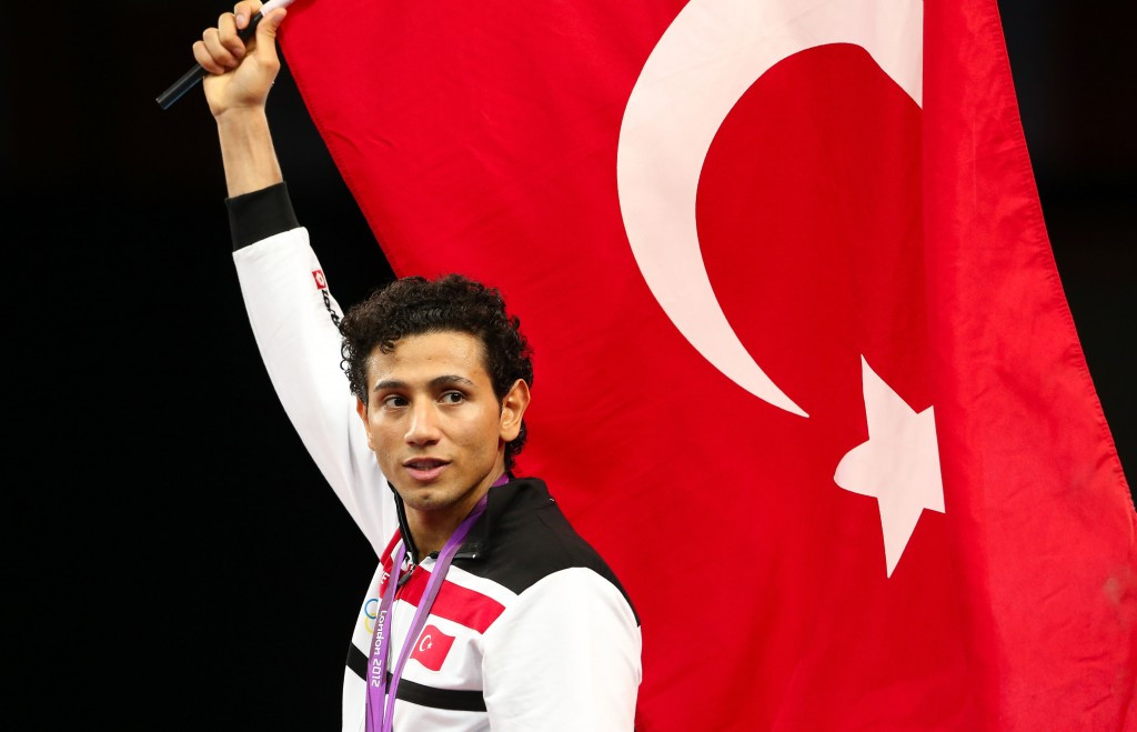 Servet Tazegul poses with the Turkish flag after winning the Olympic gold medal at London 2012 ©Getty Images