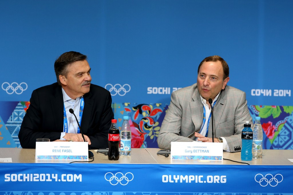 International Ice Hockey Federation President Rene Fasel and Nationla Hockely League Commissioner Gary Bettman speaking together during the 2014 Winter Olympics in Sochi ©Getty Images