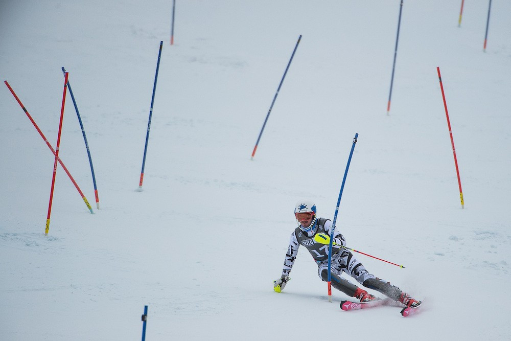 Austrian Manuel Traninger took advantage of a fall from American star River Radamus on his way to slalom gold
