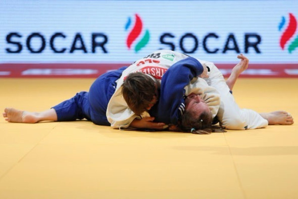 World champion Tina Trstenjak claim gold in the women's under 63kg class