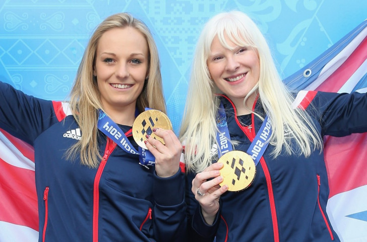 Kelly Gallagher, right, and her guide Charlotte Evans celebrate gold at the Sochi 2014 Paralympics ©Getty Images